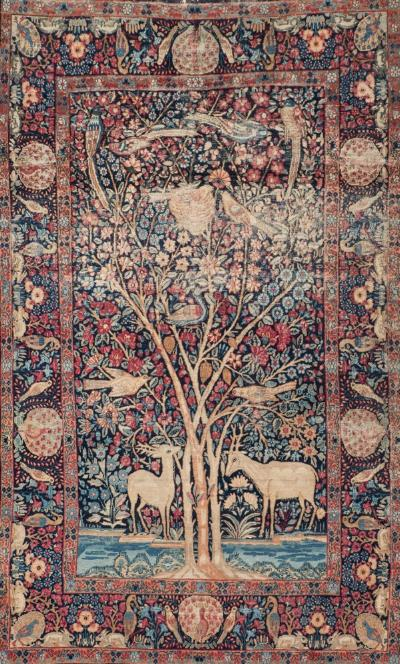 Sale FS40; Lot: 0898: An Isfahan rug, the indigo field with deer and with birds in a flowering tree, enclosed by a main indigo border with birds and flowering foliage, 214 x 134cm (some wear).