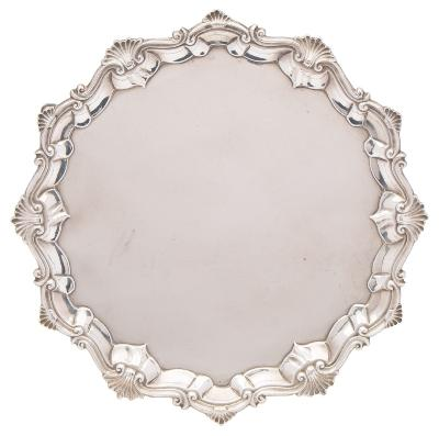 Sale FS40; Lot: 0085: A George III silver circular salver, maker Richard Rugg I, London, 1762 of circular form with moulded scroll and shell pattern border, raised on three swept feet, 31cm diameter, 930gms, 29.20ozs.