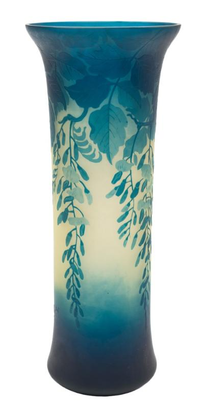 A Val St Lambert cameo glass vase of mildly waisted cylindrical form, the pale green body overlaid with blue and decorated with trailing wisteria, signed towards the base, early 20th century, 30cm high.