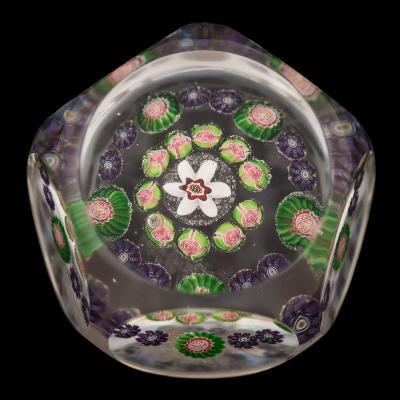Sale FS40; Lot: 0534: A Clichy miniature paperweight set with two concentric rings of coloured canes around a central flower cane beneath five printies, 4.5cm diameter.