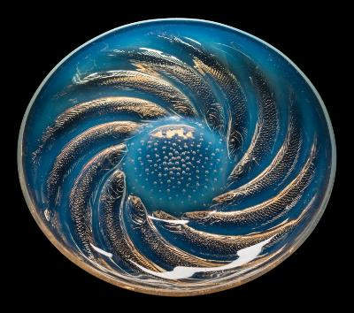 Sale FS40; Lot: 0536: A Lalique opalescent glass dish 'Poissons' the exterior intaglio moulded with bubbles and encircling fish, the interior base embossed R Lalique, 29.5cm diameter.