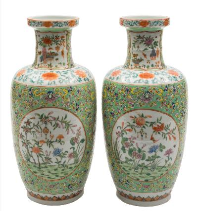 A pair of Chinese famille rose baluster vases each painted with panels of auspicious objects, bats, insects, flowers and foliage on a lotus scroll green ground, apocryphal iron red six-character Jiaqing seal marks, late 19th century, 35 cm.