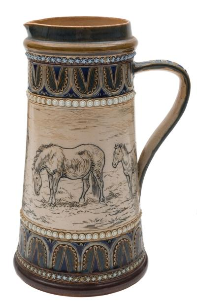 A Doulton Lambeth stoneware jug by Hannah Barlow of tapering cylindrical form, incised and decorated with four horses in a landscape within lappet, floret and beaded borders, impressed and incised marks including the artist's monogram and dated 1879, 23 cm.
