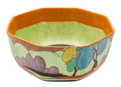 Sale FS40; Lot: 0594: A Clarice Cliff Bizarre bowl of octagonal form decorated in the Autumn (Balloon Trees) pattern with blue, purple, yellow, red and green trees on a green cafe-au-lait ground, black backstamp circa 1930-34, 22cm diameter, [some interior wear].