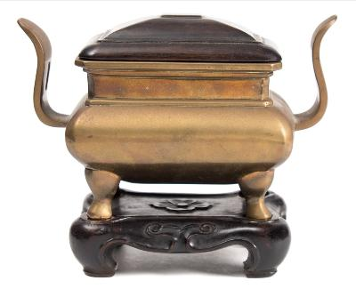 Sale FS40; Lot: 0678: A Chinese polished bronze censer of rectangular section with pierced curved handles and on cabriole legs, 18th/19th century, 18cm wide with hardwood cover and stand.