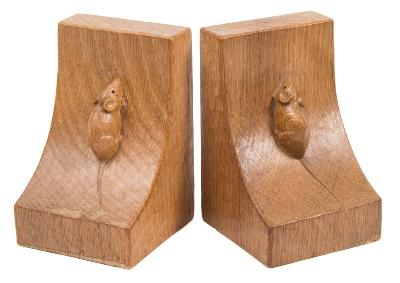 Sale FS40; Lot: 0737: A pair of Robert Thompson (Mouseman) carved oak bookends of swept square form, each with a mouse climbing up the side, 15cm high.