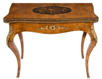 Sale FS40; Lot: 0971: A Victorian walnut, floral marquetry and gilt metal mounted card table, of serpentine outline in the French taste, bordered with boxwood lines, the baize lined hinged top with a central ebonised ground and floral marquetry cartouche-shaped panel with central bird, having a gilt metal beaded edge, the shaped apron applied with foliage, flowerheads and rocaille on cabriole legs, headed with similar decoration, trailing to sabots, 92cm (3ft 0 1/4in) wide.