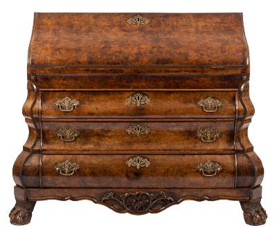 Sale FS40; Lot: 0993: An 18th Century Dutch walnut bombe bureau, the shaped and quarter burr veneered hinged fall enclosing a shaped and graduated fitted interior with small drawers and pigeon holes, about a central enclosed cupboard between turned half column concealed compartments, having a well with sliding cover, containing three long drawers below, between shaped canted angles, the shaped apron base with flowerhead and foliate ornament, on carved hair claw and ball feet, 137.5cm (4ft 6in) wide.