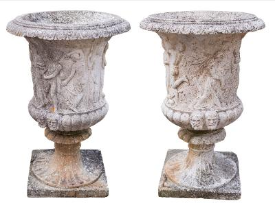 Sale FS40; Lot: 1030: A pair of reconstituted stone garden urns of campagna shape, the bodies relief decorated with classical male and female figures and with reeded bases with mask ornament on fluted socles and square bases, 94cm (3ft 1in) high, 61cm (2ft) diameter.