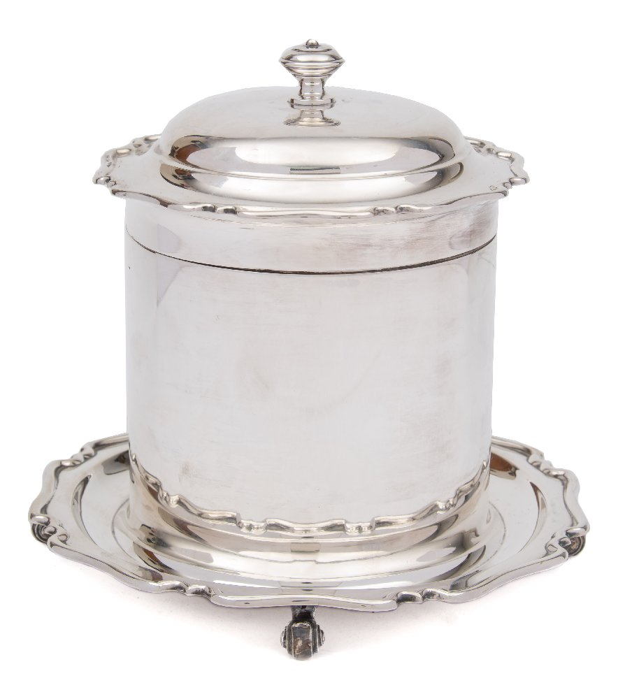 Sale FS41; Lot: 0013: A George V silver biscuit barrel, maker Atkin Brothers, Sheffield, 1914 of cylindrical outline, with shallow domed hinged lid, raised on four scroll feet, 16cm high, 706gms, 22.71ozs, together with a silver plated oval caddy.