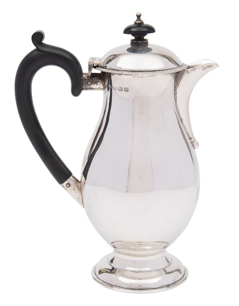 Sale FS41; Lot: 0014: A George V silver hot water jug, maker RR, Birmingham, 1913 of plain baluster form, with shallow domed hinged lid with gadrooned border, raised on a circular spreading foot, 20cm high. 424gms, 13.64ozs.