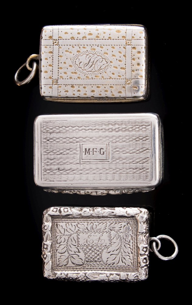 Sale FS41; Lot: 0071: A William IV silver vinaigrette, maker TS possibly Thomas Shaw, Birmingham, 1835 initialled, of rectangular outline, the hinged lid enclosing a pierced grill 3.5cm wide, together with two other silver vinaigrettes, total weight of silver 43gms, 1.40ozs.