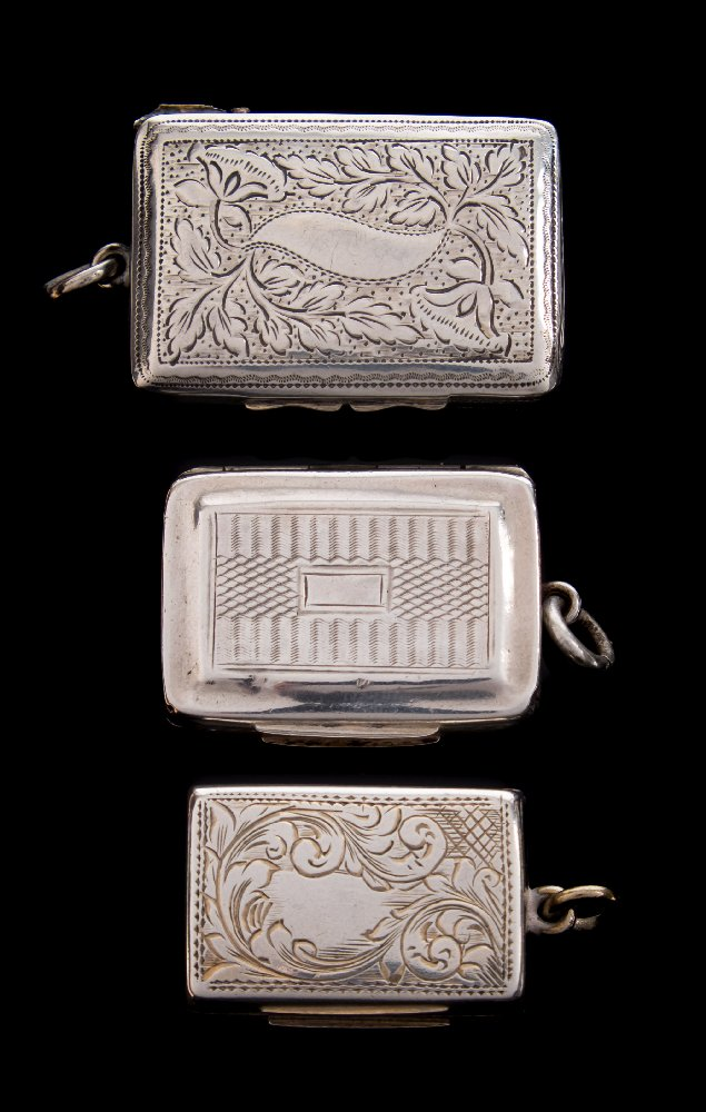 Sale FS41; Lot: 0072: A George IV silver vinaigrette, maker Thomas Newbald, Birmingham, 1826of rectangular outline the hinged lid enclosing a pierced grill 3.5cm wide, together with two other silver vinaigrettes, total weight of silver 34gms, 1.10ozs.