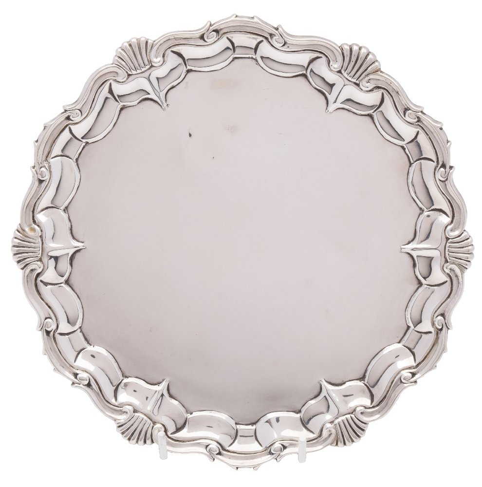Sale FS41; Lot: 0103: A Victorian silver salver, maker Joseph & Albert Savory, London, 1843 with a moulded scroll and shell border, raised on three scroll feet, 21.5cm diameter, 368gms, 11.85ozs.