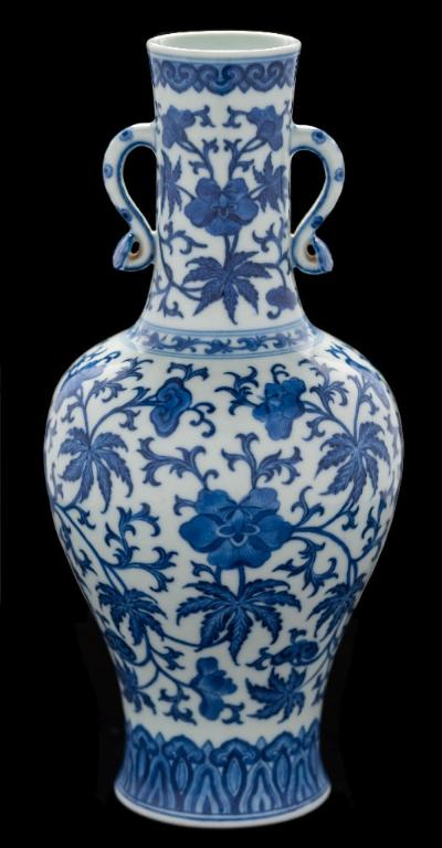 Sale FS41; Lot: 0519: A Chinese blue and white vase of baluster form with waisted slender neck and ruyi handles, painted with scrolling peony, lingzhi sprays and foliage between ruyi-head and lappet borders at the rim and foot, six-character Qianlong seal mark, bears a fragment of a collector's paper label, 27cm high [tiny flat chip to one ruyi handle terminal]. Please note there will be no online bidding for this lot. If you wish to bid on this lot you will be required to pay a deposit of £5000, which will enable you to bid by telephone, in person, or by absentee bidding (Unsuccessful bidders deposits will be refunded). All requests for bidding and all cleared funds for deposits must be received by 12 noon on Tuesday 29th January 2019.