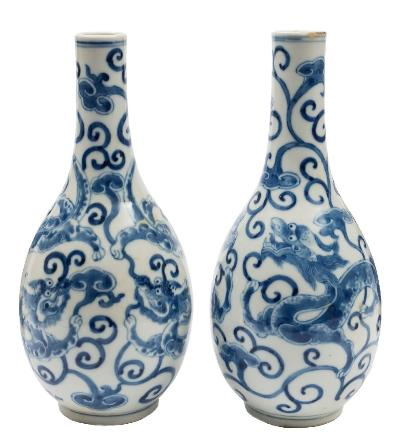 Sale FS41; Lot: 0557: A pair of Chinese blue and white bottle vases each painted with opposing dragons amongst lingzhi scrolls, double circles marks, late 19th/early 20th century, 25.5cm [one with fritting to rim].