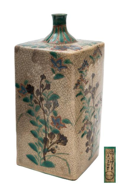 Sale FS41; Lot: 0562: A Japanese Ko-Kiyomizu crackle glazed sake bottle [tokkuri] of square section enamelled with stylised flowers and foliage below a lappet border to the rim, Edo period, 19cm [minor damage].