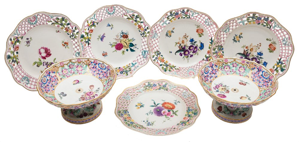 Sale FS41; Lot: 0667: A pair of Meissen porcelain comports and a set of five Herend dishes with pierced rims and painted with fruit and floral sprays, the comport bases moulded with laurel garlands, the comports with underglaze blue crossed swords marks, circa 1900, 19cm, the dishes with various impressed and painted marks, 22 cm.