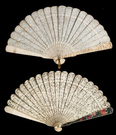 Sale FS41; Lot: 0699: A 19th century Cantonese ivory brise fan carved to both sides with figures in a pagoda landscape, 19.5cm long, together with a similar fan with stained guards, 19cm long.