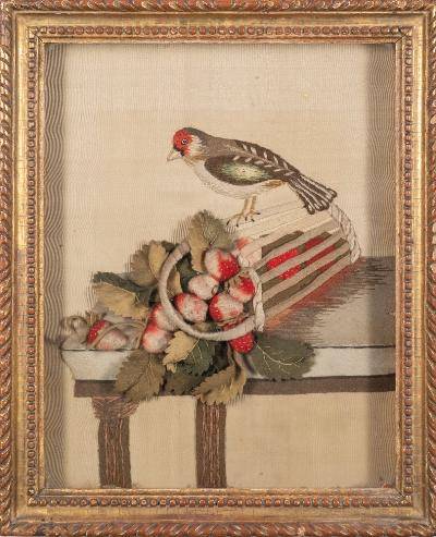 Sale FS41; Lot: 0711: An early 19th century felt and needlework picture depicting a chaffinch perched on an upturned basket of strawberries, contained within a gilt frame, 30cm x 24cm.