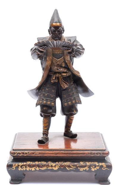 Sale FS41; Lot: 0769: Miyao Eisuke of Yokohama, a bronze study of a Samurai warrior standing with outstretched arms holding an open fan, signed Miyao Ei, mounted on a rectangular and gilt decorated wood stand, overall height 21cm.