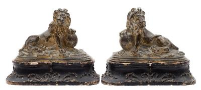 Sale FS41; Lot: 0848: A pair of 18th century gilt-bronze lions modelled as an opposing pair, each seated with a front paw resting on a globe, 11cm high, 16cm wide, on original wood stands with applied gesso foliate scrollwork.