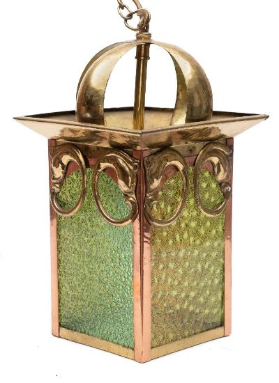 Sale FS41; Lot: 0869: An Arts and Crafts copper and brass hall lantern of rectangular outline, held on strap work suspensions, with green glass panels to the sides, overall height, 38cm.