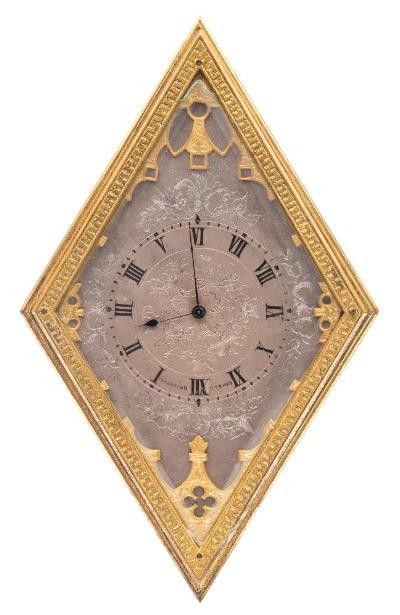 Sale FS41; Lot: 0881: Boxell, Brighton an easel clock in the manner of Thomas Cole the eight-day duration timepiece movement having a lever escapement, the diamond shaped silvered dial with engraved decoration, black Roman numerals and blued-steel spade hands and painted with the name of the retailer Boxell, Brighton, either side of XI o'clock, the diamond shaped gilt-brass case with engraved decoration and with an easel stand to the rear, complete with travelling case, height 15.5cm * Biography Boxell of Brighton were a well-known retailer who, amongst other items, sold clocks by the best of the French carriage clock makers as well as English clocks made by Thomas Cole and others.