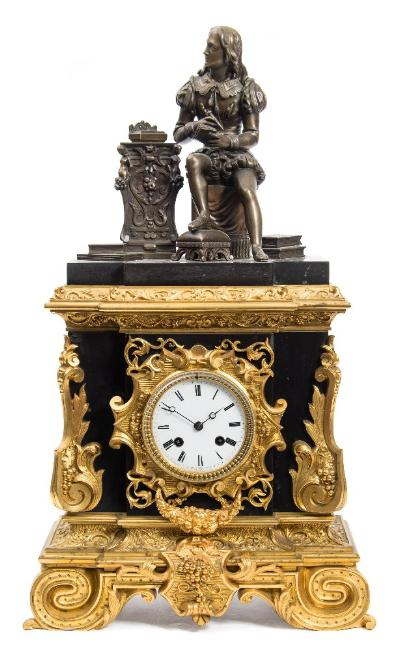Sale FS41; Lot: 0884: Delettrez a Paris, a bronze and ormolu mantel clock the eight-day duration movement striking the hours and half-hours on a bell with an outside countwheel and having Brocot regulation to the pendulum, the backplate stamped Delettrez, Paris, the round white enamel dial having black Roman numerals, blued steel hands and with a repeat of the signature below VI o'clock, the bronze case profusely decorated with ormolu mounts to the front and edges and standing on a richly decorated ormolu base, surmounted by a bronze figure probably depicting the 17th century French playwright, poet and actor, Jean-Baptiste Poquelin better known by his stage name, Molière, seated in a thoughtful pose whilst writing, height 53cm * Biography. Jean-Antoine Delettrez was a well-known Parisian clockmaker, working from 1851in partnership with Achille Brocot, son of the maker Louis-Gabriel, at rue Charlot 62 and with whom he continued the development of the Brocot form of pendulum adjustment for regulation of timekeeping first developed by Brocot père and for which they were awarded a medal at the Paris Exposition of 1855 Following the death of Achille Brocot in 1878, Delettrez continued alone and died in May 1887.