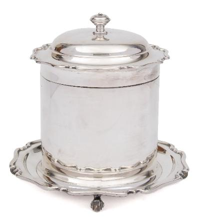 A George V silver biscuit barrel, maker Atkin Brothers, Sheffield, 1914 of cylindrical outline, with shallow domed hinged lid, raised on four scroll feet, 16cm high, 706gms, 22.71ozs, together with a silver plated oval caddy.