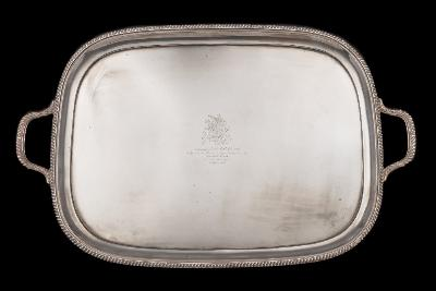 Sale FS41; Lot: 0035: A large George V silver serving tray, maker Harrison Brothers & Howson, Sheffield, 1920 crested and inscribed, of rectangular outline with gadrooned border and loop carrying handles, 72cm wide, 4235gms, 136.17ozs.