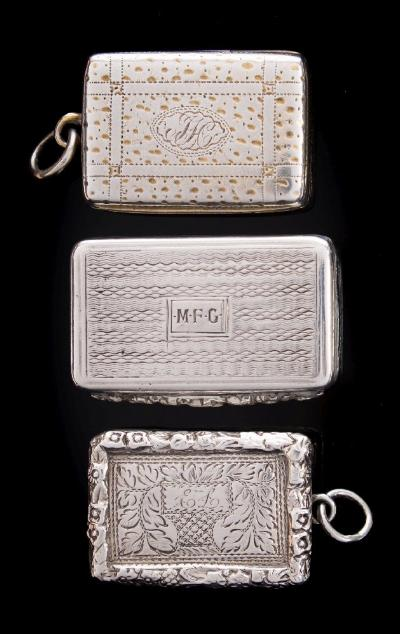 A William IV silver vinaigrette, maker TS possibly Thomas Shaw, Birmingham, 1835 initialled, of rectangular outline, the hinged lid enclosing a pierced grill 3.5cm wide, together with two other silver vinaigrettes, total weight of silver 43gms, 1.40ozs.