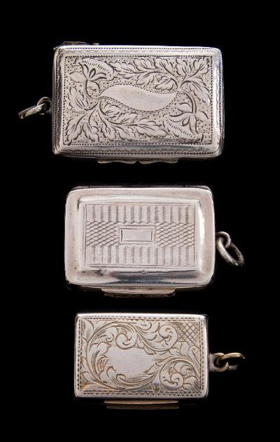 A George IV silver vinaigrette, maker Thomas Newbald, Birmingham, 1826of rectangular outline the hinged lid enclosing a pierced grill 3.5cm wide, together with two other silver vinaigrettes, total weight of silver 34gms, 1.10ozs.