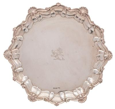 Sale FS41; Lot: 0101: A Victorian silver salver, maker Atkin Brothers, Sheffield, 1897 crested, with shell and scroll border, raised on three swept feet, 32cm diameter, 764gms, 24.56ozs.