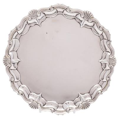 A Victorian silver salver, maker Joseph & Albert Savory, London, 1843 with a moulded scroll and shell border, raised on three scroll feet, 21.5cm diameter, 368gms, 11.85ozs.