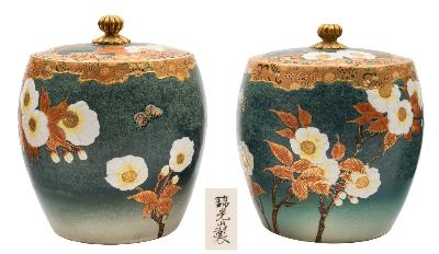 Sale FS41; Lot: 0563: A pair of Satsuma earthenware jars and covers of barrel shaped form decorated with flowering prunus and butterflies on a sea green ground below narrow diaper borders, signed Kinkozan, Meiji, 16cm high.