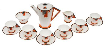 A Shelley Mode coffee service with 'cubist' decoration comprising a coffee pot and cover, milk jug, sugar bowl, six cups and six saucers each decorated with a cluster of orange, black and silver lustre squares, black backstamps and pattern No 11786, circa 1930-35, [tiny rim chip to cream jug].