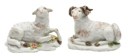 A pair of Chelsea models of a recumbent ewe and ram their fleeces with greyish brown markings, on mound bases applied with flowers and leaves, red anchor marks, circa 1755, 9cm [restoration to ewe's ears, minor losses to ram's horns and leaves].