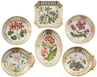Sale FS41; Lot: 0644: A fine early 19th century Coalport botanical part dessert service painted with named botanical specimens within pierced rims highlighted with anthemion and floral gilding, each titled in blue enamel to the reverse, circa 1820; comprising eight plates, 22 cm; two shell-shaped dishes, 26 cm; an oval dish 28cm and an octagonal dish, 22cm (12) *Note. The botanical specimens probably taken from 'Curtis's Botanical Magazine'.
