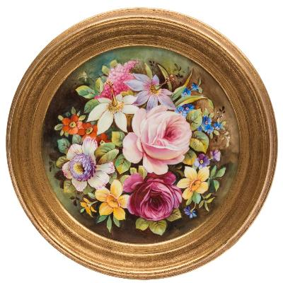 A late 19th century English porcelain circular plaque painted by R James with a bouquet of summer flowers, signed, 13.5cm diameter, framed.