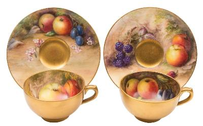 Sale FS41; Lot: 0659: A pair of Royal Worcester fruit painted cabinet cups and saucers painted respectively with apples, grapes, blackberries, currants and cherries on a mossy ground, one cup and saucer signed Ricketts and one cup Lockyer, puce marks and datecode for 1916 and 1917 respectively, saucer 9.5cm diameter.