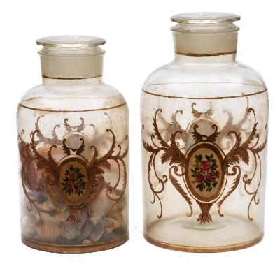 Sale FS41; Lot: 0697: A pair of late 19th Century glass shop window jars and covers each with gilt cartouches containing flowerhead decoration, 46cm high.