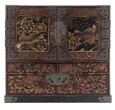 A Japanese lacquered Kodansu of rectangular outline, with a pair of panel doors decorated with a peacock and peahen enclosing six short drawers, with two short and one long drawer below, with floral decoration to the top and sides, on a plinth base, 45cm wide.