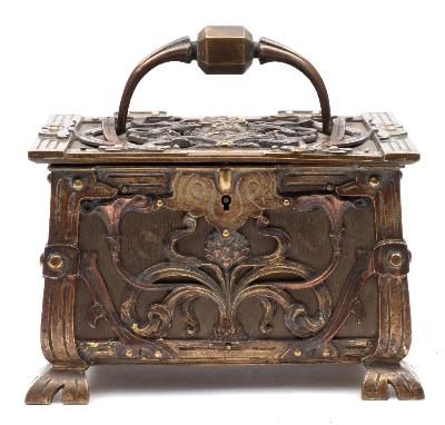 Sale FS41; Lot: 0826: A Continental Art Nouveau period brass and copper casket the hinged lid with loop carrying handle and female mask decoration enclosing a velvet lined interior, the front and sides decorated with stylised flowers raised on pierced bracket feet, 20cm wide.