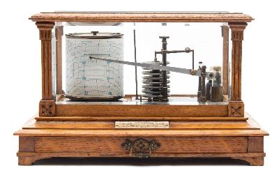 Sale FS41; Lot: 0913: Short & Mason, London, an oak cased barograph the glazed oak case having flat fluted columns to the corners, with a sheet drawer to the front, a plaque attached to the interior base signed Short & Mason, London complete with ink bottle, with a presentation plaque to the front dated 1905, height 21cm * Biography Short & Mason are recorded as compass and nautical instrument makers at 62 Hatton Garden from 1873 until 1875 and then 40 Hatton Garden until after 1900, being well known for their barographs.