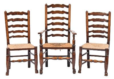 Sale FS41; Lot: 0952: A harlequin set of eight early 19th Century elm and ash 'Wavy' ladderback dining chairs, having rush seats on turned tapered legs, united by stretchers, terminating in pad feet - including two elbow chairs.