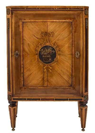 An early 19th Century Dutch satinwood, rosewood crossbanded and inlaid dwarf side cabinet, bordered with boxwood lines, the top with cut corners having a narrow lacquered panel frieze and apron base enclosed by a quarter veneered panel door with tulipwood crossbanded border, centred by a ribbon tied roundel decorated in gilt in Shibyama style on an ebonised ground with an urn of flowers and foliage, the ebonised canted angles with applied gilt metal rosette and pendant foliate ornament, on square tapered legs, terminating in brass bun feet, 59cm (1ft 1 1/4in) wide, 90cm (2ft 11 1/2in) high.