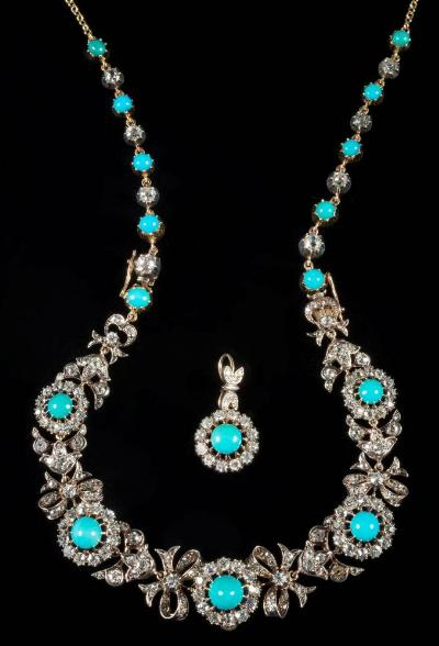 A turquoise and diamond mounted necklace with 19th century circular clusters each with a central round turquoise, the largest being 7.2mm diameter, joined by ribbon bow-shaped links, suspending a later circular cluster pendant and with extension links of graduated individual round turquoise and diamonds on a trace-link chain with diamond-set clasp, the diamonds estimated to weigh a total of 8 5cts, approximately 37.5gms gross weight.
