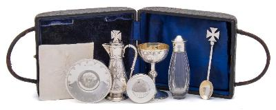 A 20th century matched six piece travelling communion set, various makers and dates includes chalice, paten, pyx, wine ewer etc., cased, 200gms, 6.46ozs.