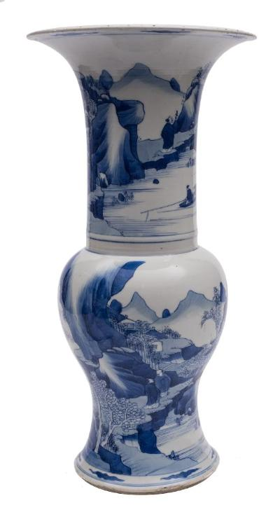 A Chinese blue and white yen yen vase the neck and base painted with extensive mountainous lake scenes with scholars, fishermen and buildings, double circles mark, Kangxi, 45cm [riveted repair to rim, minor chips].